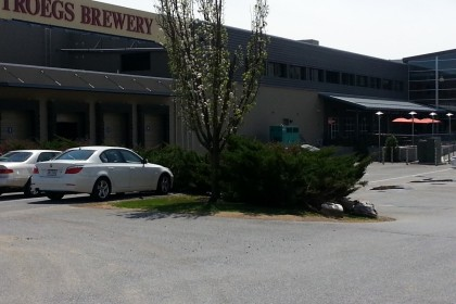 Steel sided industrial building with cream sign reading Troegs Brewery in large red letters.