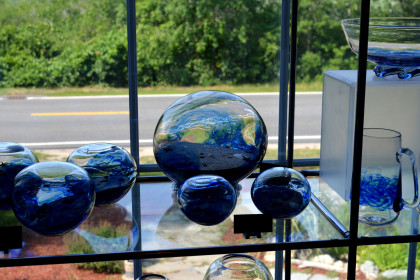 large and small blown glass bubbles in blue colors