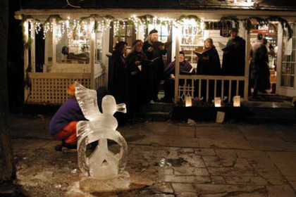 ice sculpture of bird and carolers in front of store windows
