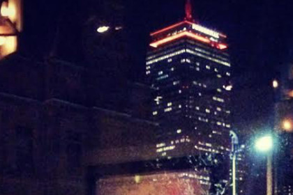 Night Skyline Boston Tall Building with Orange Lights and snow on ground