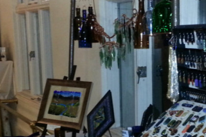 gift items of jewelry, small art, and bath products displayed