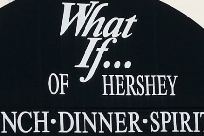 Black curved awning entry with white letters reading What If ... of Hershey, Lunch-Dinner-Spirits