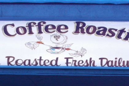 Sign with Alaska Coffee Roasting Co., Roasted Fresh Daily