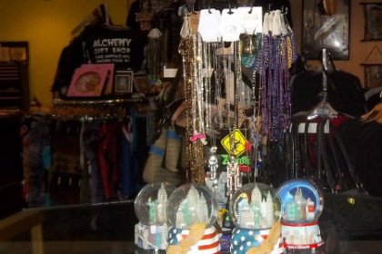 the view from the front door into the shop, including but not limited to, imported incense, necklaces, skirts, shirts, hats and decorative pieces
