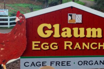 red sign with red chicken reading Glaum Egg Ranch