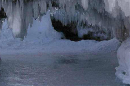 frozen Lake Superior within sandstone cave covered with ice