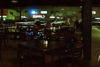 Inside of Riverbend Billiards with tables and chairs and pool tables