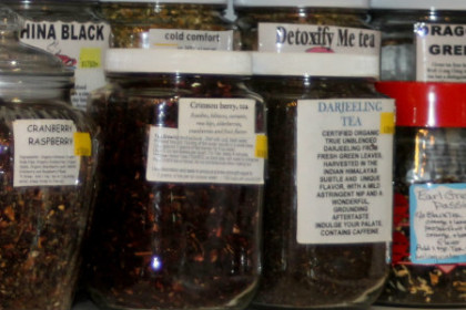 teas and herbs in glass jars with descriptive labling