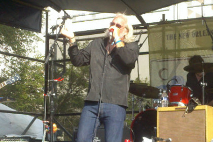 Johnny Sansome holding microphone and singing