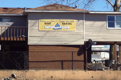 Brown building with Grafton Kayak in yellow letters on side