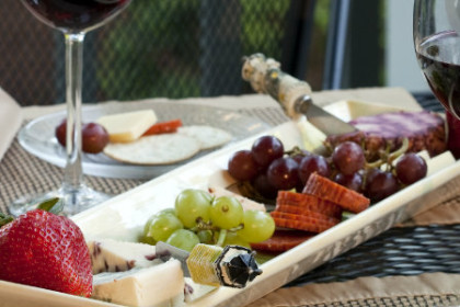 White ceramic platter with fruit and cheese