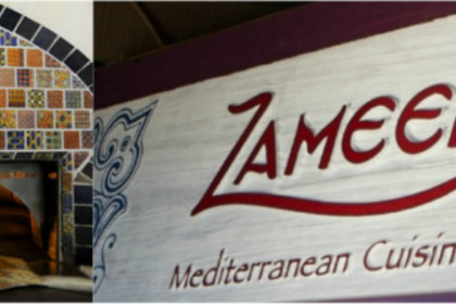 White sign with Zameen mediterranean Cuisine printed on it