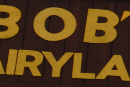 Yellow text on brown background outside sign bob's dairyland