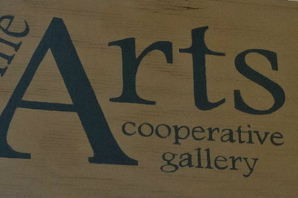 wood sign with C'ville Arts cooperative gallery in black