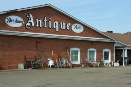 Strasburg Antique Mall, large one story brick building with name of business across the top of building in white lettering.