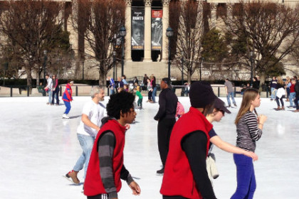 People ice skating on the ice rink