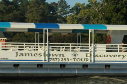 White pontoon boat with blue and white roof