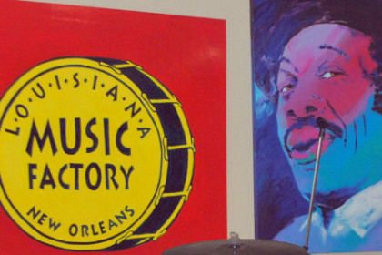 Inside wall of store with Lousiana Music Factory written on yellow drum