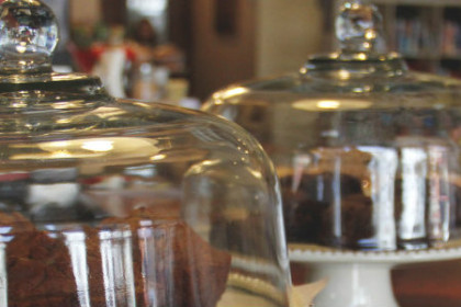 Glass covered cakeplate with chocolate desserts displayed