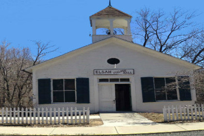 1 story white building that looks like an old school house with bell tower