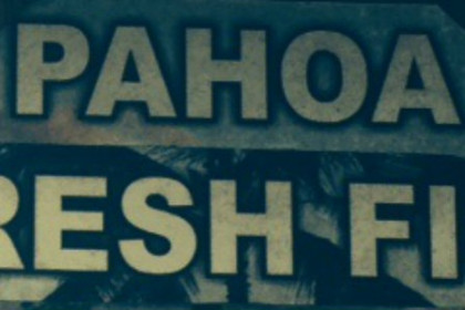 Sign reading Pahoa Fresh Fish in green and beige