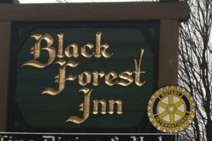 "Brown sign with words ""Black Forest Inn"" in gold lettering"