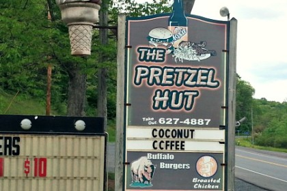 "A sign with the words ""The Pretzel Hut"" and the funky ice cream flavors for the week."
