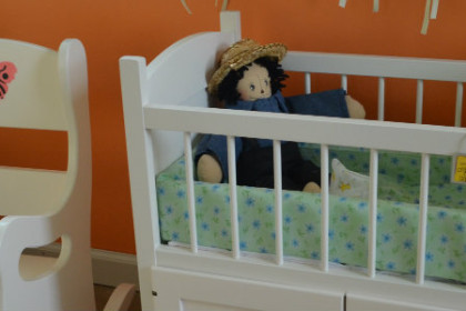 Child's crib and chair, both in white