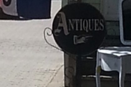 Front of Antique store with antiques on sidewalk
