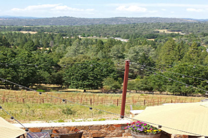 Umbrellas and a fireplace in foreground with a view of the Fair Play Valley