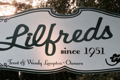 A very large black/white sign, Lilfreds welcomes you to fine dining.