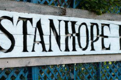Rustic wooden sign with blue lettering - The Stanhope House