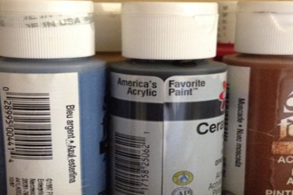 A close-up view of assorted paints to be used at a paint party.