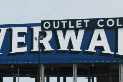Riverwalk sign, large white letters on a blue background