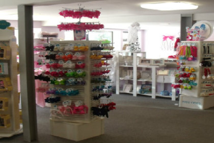 Inside look of The Grapevine Store, racks of clothes and accessories