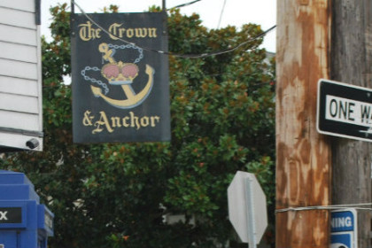 brown signage with an painted anchor