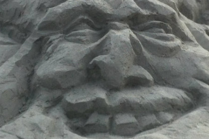 Sand face with smile