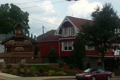 Picture of Sugarcreek, Ohio featuring the World's largest cuckoo clock. Large brown cuckoo clock with dancing swiss figures