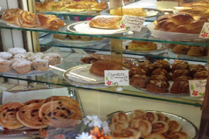 The counters of Mulberry Market are filled with fresh baked croissants, pastries, muffins...