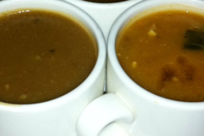 2 white cups filled with gumbo