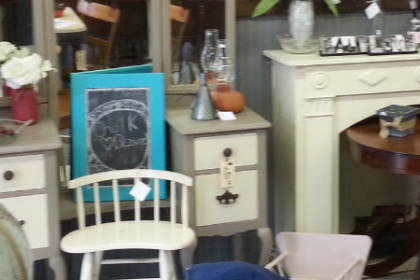picture of the inside of Tattered and Worn Shop showing a clutter of furniture, home decorative items all refurbished and ready for re-sale.