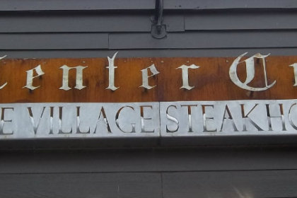 Bronze sign with silver relief lettering