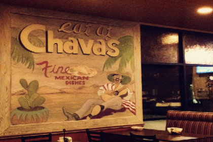Restaurant interior with large painted sign reading Chavas