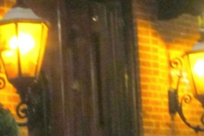 Brightly lit lanterns flank either side of the dark wood door to the red-bricked Belvedere Restaurant