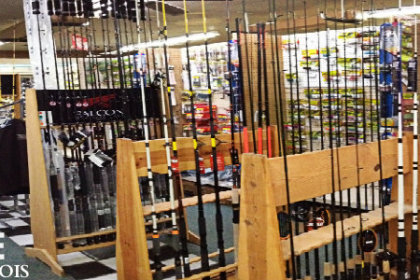 interior of fishing & tackle shop with fishing rods and other equipment on display