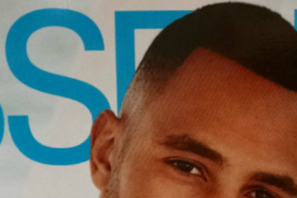 photo of a cover of Essence Magazine featuring the face of a black young man