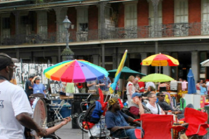 caption of a local brass band entertaining vistors in Jackson Square
