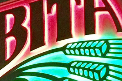 Close up photo of neon Abita sign.